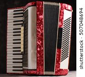 Small photo of Mother of pearl accordion on a black background.