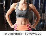 Small photo of Beautiful female abs in gym