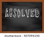 Small photo of ABSOLVED hand writing chalk text on black chalkboard