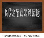 Small photo of ABSTAINED hand writing chalk text on black chalkboard