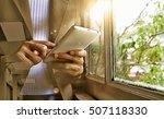businesswoman holding mobile... | Shutterstock . vector #507118330