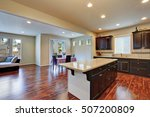 Stock photo kitchen and dining room interior with dark tone hardwood floor northwest usa 507200809