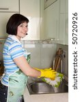 woman washing dishes in kitchen.... | Shutterstock . vector #50720926