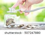 stethoscope on bottle and coin... | Shutterstock . vector #507267880