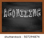 Small photo of AGONIZING hand writing chalk text on black chalkboard