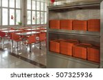 Stock photo orange plates in mess hall 507325936