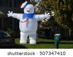 Small photo of Lancaster, PA - October 28, 2016: A large blowup Halloween yard decoration of the Ghostbusters Stay Puft Marshmallow Man on display.