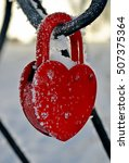 Small photo of The lock is fastened on a metal rod covered with snow and frost, epitomizes the strength of feelings, in spite of any adversity/Locks wedding