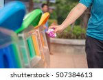 hand throwing plastic bag into ... | Shutterstock . vector #507384613