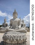 Small photo of Aligned Sitting Buddha Statues at Thailand