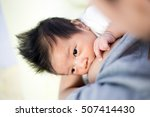 young mother breastfeeding the... | Shutterstock . vector #507414430
