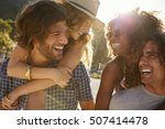 two couples piggybacking at the ... | Shutterstock . vector #507414478