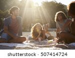 four friends having a picnic on ... | Shutterstock . vector #507414724