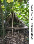Small photo of CORNWALL, ENGLAND - August 25, 2016: Indigenous living quarters, situated in the Tropical biome at the Eden Project in Cornwall, England.