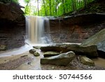 Blue Hen Creek Falls in Cuyahoga National Park, Ohio. Surrounded by lush forest on a summer day after a heavy rainfall.