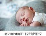 Newborn Baby Boy Lying On Bed ...