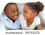 Portrait Of Laughing Siblings...