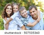 parents giving children... | Shutterstock . vector #507535360