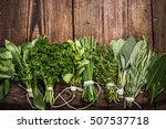 bunch of fresh herbs on wooden... | Shutterstock . vector #507537718