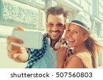 happy couple taking a selfie... | Shutterstock . vector #507560803