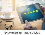 businessman holding five star... | Shutterstock . vector #507624223