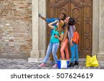 Stock photo group of young multi cultural friends on a day out in an old city taking a selfie photo using 507624619