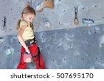 little girl climbing a rock... | Shutterstock . vector #507695170