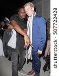 "Small photo of Aaron Carter (r) and a guest at the ""2016 Fashion Tails Adopt A New Attitude"" Coffee Book and Art Exhibit benefit on Oct. 6, 2016 at Lombardi House in Los Angeles, CA."