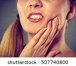 Small photo of Dental care and toothache. Young woman achy girl suffering from terrible tooth pain, touching pressing her cheek by hand palm closeup