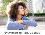cheerful ethnic girl relaxing... | Shutterstock . vector #507761533