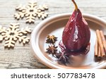 merlot poached pear on the plate | Shutterstock . vector #507783478