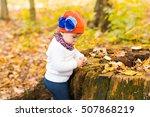 little baby girl in the autumn... | Shutterstock . vector #507868219