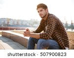 pensive young man in plaid... | Shutterstock . vector #507900823
