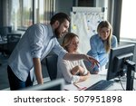 coworkers looking at a computer ... | Shutterstock . vector #507951898