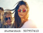 two gorgeous trendy young women ... | Shutterstock . vector #507957613
