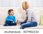mother and son sitting on sofa... | Shutterstock . vector #507982210