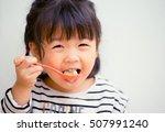 happy little asian girl eating... | Shutterstock . vector #507991240