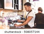 waist up of a bearded barista... | Shutterstock . vector #508057144