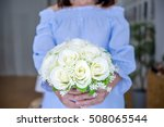 Woman Holding Wedding Bouquets...