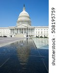 Stock photo bright scenic view of the us capitol building in washington dc reflecting on water under clear 508195759