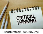 Small photo of Critical thinking text written on a notebook with pencils