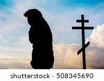 believer prays at sunset near... | Shutterstock . vector #508345690