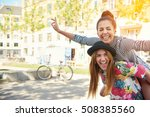 laughing young female friends... | Shutterstock . vector #508385560