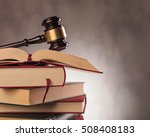 Judge's Gavel On Top Of A Stac...