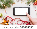 Small photo of Woman using smartphone with blank screen, festive trumpery frame. Christmas gift search, online shopping, seasonal discounts and sale concept