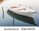 White Moored Boat On A River...