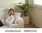 young man listening to music on ...   Shutterstock . vector #50842342