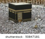 MECCA - JAN 2 : Close up view of Muslim pilgrims circumambulate the kaaba at Haram Mosque Jan 2, 2008 in Mecca. Millions of muslims around the world come for hajj during this time. - stock photo
