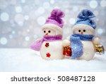 Snowman Couple With Scarfs On...