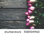 Pink Roses Bouquet Over Wooden...